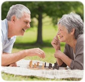 Older Couple playing chess crop round